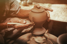 Potter Makes On The Pottery Wheel Clay Pot.
