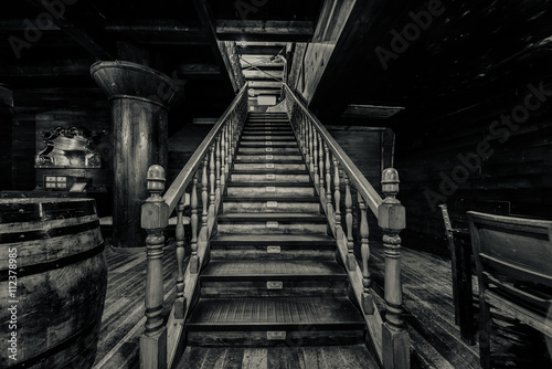 Wooden staircase. Interior of old pirate ship. Black and white