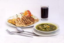 Peruvian Dish: Chicken Soup Of Coriander  Chicha Morada