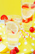 detox , healthy and refreshing drink , lemonade, Nutritious cold sparkling water with fresh strawberry and lemon on a wooden background