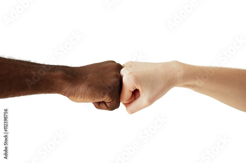 Black african american man touching knuckles with white caucasian black african american man touching knuckles with white caucasian woman in agreement partnership and cooperation m4hsunfo