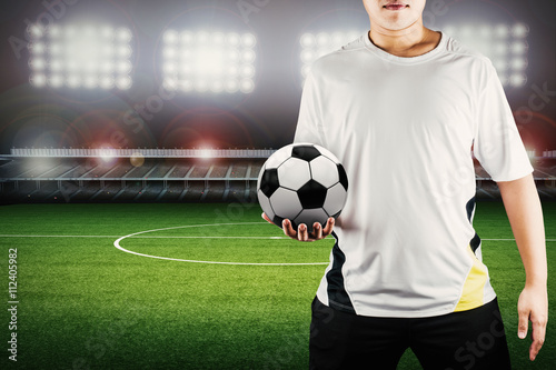 Fotografie, Tablou  player holding ball with stadium background