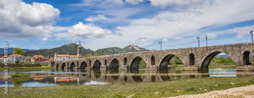 Fotografie, Obraz  Panorama of roman bridge in Ponte de Lima