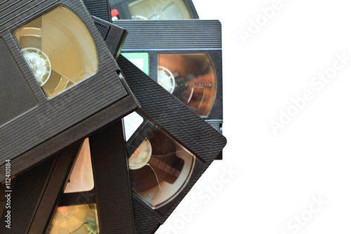 Tela stack of old vintage videotapes. video cassettes isolated on whi