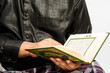 Muslim Man Reading The Koran