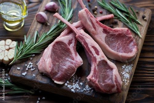 Fotografering  Close-up of raw fresh lamb shoulder rack steaks, selective focus