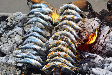 FototapetaSardines to grilled on the beach in Malaga Spain