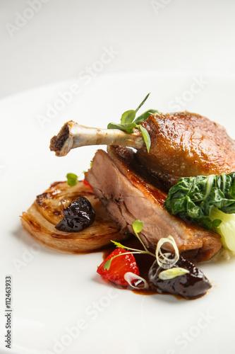 Deurstickers Klaar gerecht Well-browned and crisp duck confit with roast fennel, citrus fruit and prune sauce. Roasted Duck leg. White dish