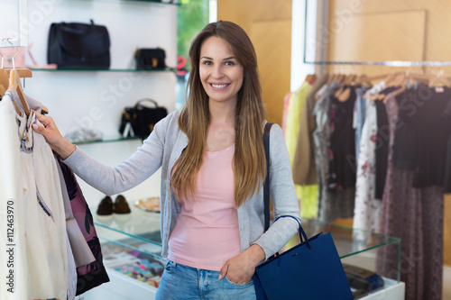 Fototapety, obrazy: Woman shopping in a clothing boutique