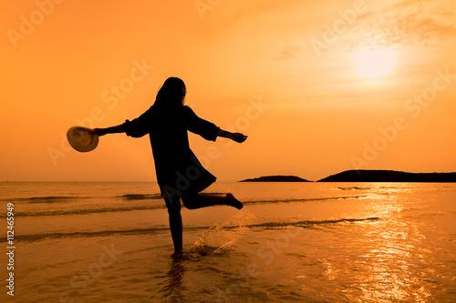 silhouette happy woman walking on beach happy young woman walking