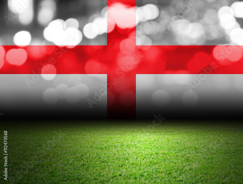 Tableau sur Toile Soccer field and bokeh with england flag