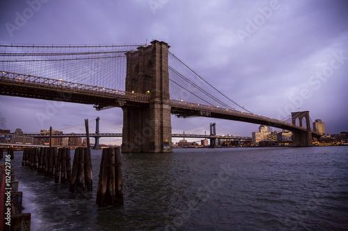 Fotobehang Brooklyn Bridge The Brooklyn Bridge in New York City from Seaport at sunrise.