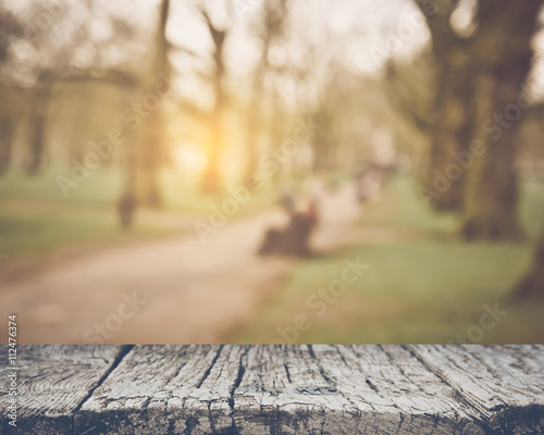 Staande foto Natuur Blurred Park Bench Outdoors with Retro Style Filter