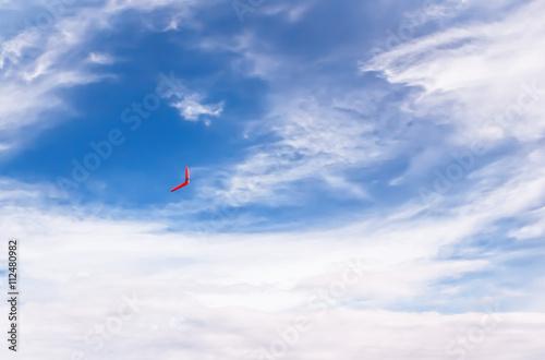 Photo  Red boomerang in flight