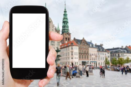 Photo  tourist photographs Amagertorv in Copenhagen