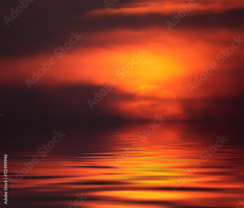 Wall Murals Magenta Fiery sunset with reflection in water