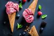 Leinwandbild Motiv Sweet ice cream with berry fruits in waffels