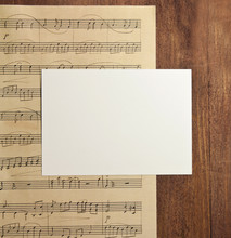 Blank White Post Card With Copyspace, On Aged Sheet Music