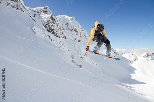Snowboard rider jumping on mountains Canvas Print