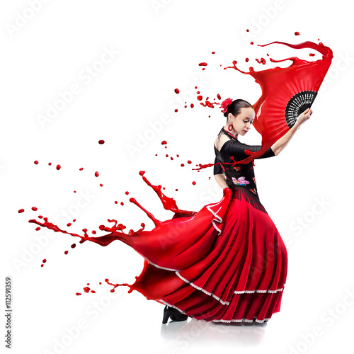 Photo  young woman dancing flamenco with paint splashes isolated on whit