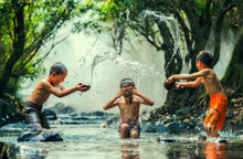 Childs Splashing In The River