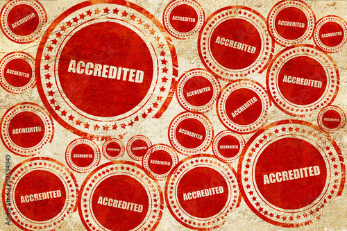 accredited, red stamp on a grunge paper texture Canvas Print