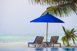 Sunbeds and umbrella at beautiful tropical resort