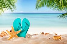 Summer Flipflop On Sandy Beach
