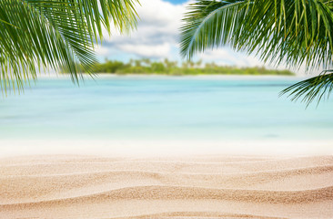 Sandy tropical beach with island on background
