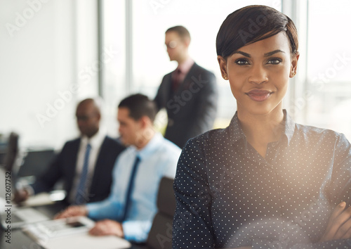 Photo  Young business owner in office with employees