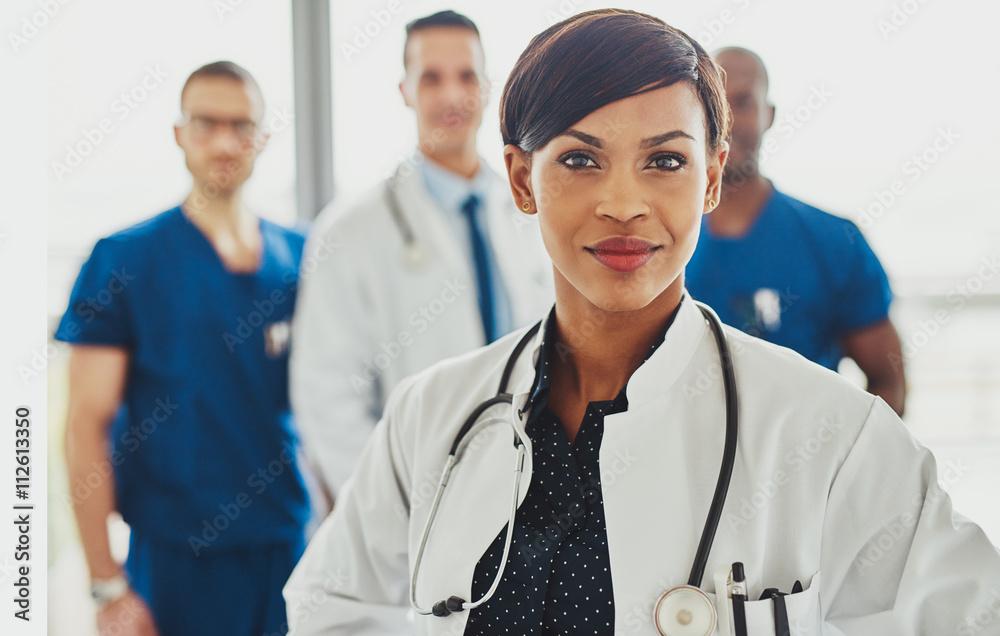 Fototapety, obrazy: Black female doctor leading medical team