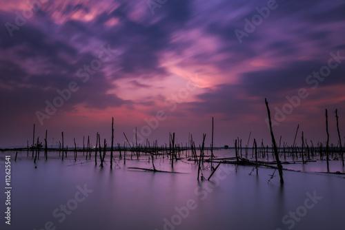 Fototapeta Long exposure on the beach with the oyster farms obraz na płótnie