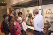 Leinwanddruck Bild - Students Looking At Artifacts In Case On Trip To Museum