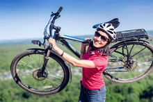 Young Woman Biker Hold Her Bike Up Happy Smiling Outdoor. Cross Country Female Biker Relaxing After Riding A Bicycle Race