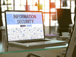 Modern Workplace with Laptop Showing Landing Page in Doodle Design Style with Text Information Security. Toned Image with Selective Focus. 3D Render.