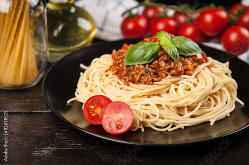 Fotografia  Spaghetti bolognese on dark background