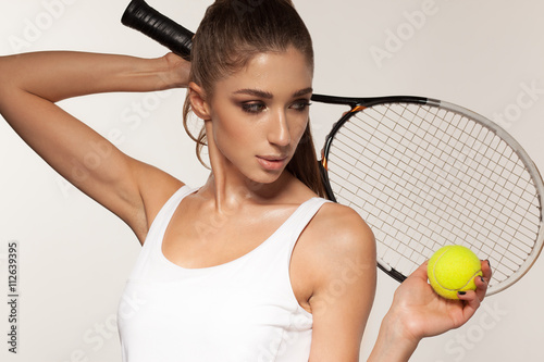 portrait of beautiful fitness sexy woman, tennis player with racket Wallpaper Mural