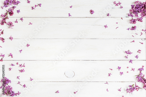 lilac flowers on white wooden background, top view, flat lay