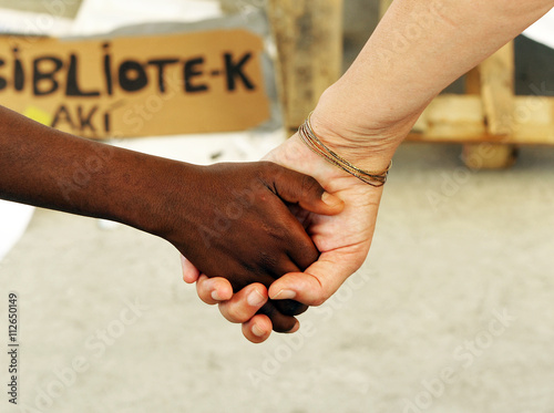 Photo Black hand and white hand, mother of adoption, race mixing
