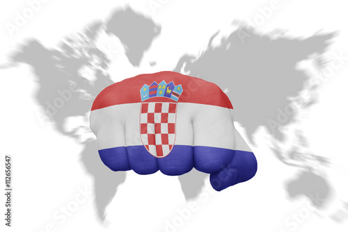 fist with the national flag of croatia on a world map background ...