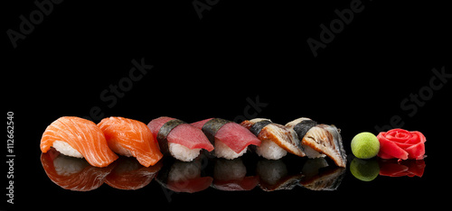 Tuinposter Sushi bar Sushi nigiri set over black background