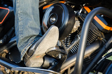 Bikers Boot And Motor Close-up