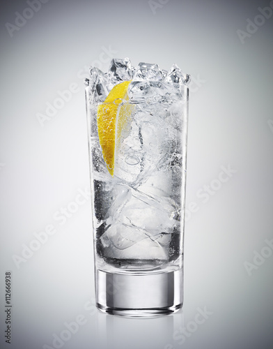 Refreshing drink with soda and lemon