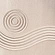 Raked sand patterns in Japanese Zen Garden