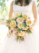 Cropped View Of Woman In Wedding Dress Carrying Bouquet