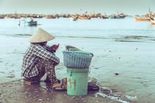 Woman Sitting On The Beach In Mui Ne, Vietnam