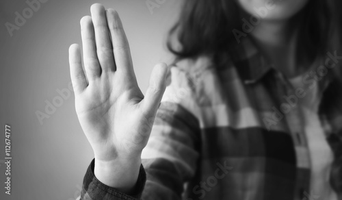 Girl showing stop hand sign gesture (Body language, gestures, ps