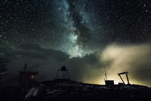 Cabin At Oil Field Against Starry Sky At Night