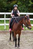 Fototapeta Konie - young girl on a horse