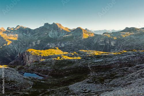 Sunlight shining on rocky mountains